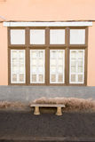 Window and bench of the old house Stock Photos