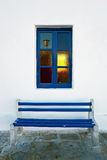 The window and the bench of the unknown house in Mykonos, Greece Stock Image