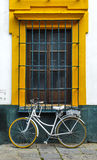 Window Bike. Bike standing in front of a yellow window Stock Image