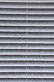 Window Blind background. Partially open white window blind for background Stock Photo
