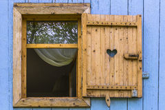 Window with blind. Open wooden window with blind in countryside in Poland stock photography