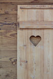 Window blind of a wooden hut with a heart shaped hole Royalty Free Stock Image