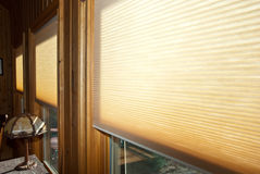 Window Blinds. Modern style honeycomb blinds in windows of a home royalty free stock image