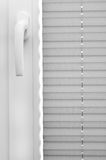 Window blinds. Closed and a window handle Royalty Free Stock Images