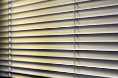 Window Blinds. Metal Blinds with drawstring. Roller Shutter Background Stock Photo