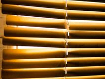 Window blinds. Yellow window blinds on a sunny day stock images