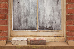 Window blocked out with white paint Stock Photo