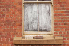 Window blocked out with white paint Royalty Free Stock Image