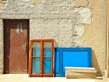 Window and Blue Door on the Old Wall Stock Photo