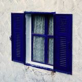 Window With Blue Frame and Shutters Stock Image