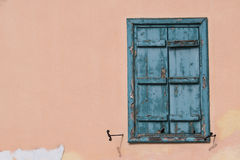 Window with blue shutter Stock Image