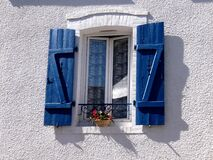 Window with blue shutters Royalty Free Stock Photos
