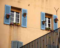 Window with blue shutters on beige walls in Marseille Royalty Free Stock Images