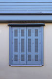 Window with blue shutters Stock Photography