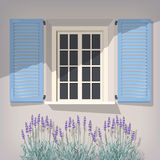 Window with blue shutters Royalty Free Stock Images