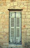 Window with blue shutters in mediterranean house. Stock Photo