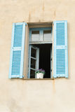 Window with blue shutters Stock Image