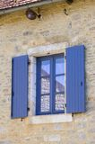 Window with blue shutters Royalty Free Stock Photography