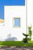 Window with blue shutters Stock Images