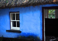 Window In Blue Thatched Roof House Royalty Free Stock Photos