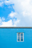 Window in blue wall Stock Photos
