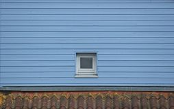 Window In Blue Wooden Wall Royalty Free Stock Photo