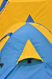 Window of blue and yellow tent. Part and detail window of tent, shown as outdoor goods, and colored pattern Stock Photography