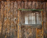 Window of a Boarded up log cabin Stock Photo