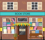 The window of a bookstore. Flat style. A lot of books on the shelves. Lantern and bench outside. Literary shop. Street showcase. Vector illustration Stock Photos