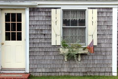 Window box. Rural type cape front with window box with american flag Stock Photography