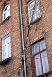 Window on the brick facade of an old house with hanging lights o. N wires Royalty Free Stock Images