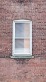 Window on brick red wall Royalty Free Stock Photography