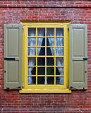 A window in brick wall. A yellow window in brick wall Royalty Free Stock Photo