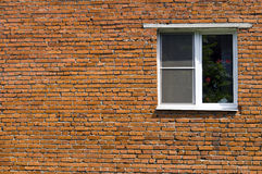 Window at the brick wall Royalty Free Stock Photo