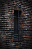 Window in a brick wall Royalty Free Stock Photo