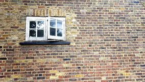 Window. On the brick wall Stock Image