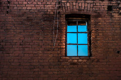 Window at the brick wall. Of the abandoned building public property Stock Photos