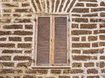Window in a brick wall Royalty Free Stock Image