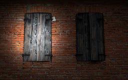 Window on brick wall illuminated by a flashlight. Stock Image