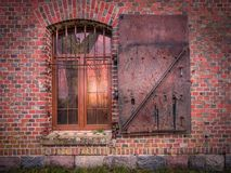 Window in brick wall with metal cell. View of window in brick wall with metal cell royalty free stock photos