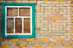 Window in a brick wall. Old shabby box country house Royalty Free Stock Images