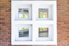Window in brick wall with view inside the interior Royalty Free Stock Photos