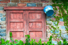 Window in a brick wall with wooden shutters Stock Image