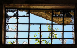 Window with broken glass. In front of a sunny sky Royalty Free Stock Images
