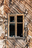 Window with broken glass in a wooden abandoned house Royalty Free Stock Photo