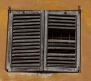 Window with broken shutter Stock Image