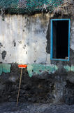 The window and the broom. Cape Verde old house with delapidated pebbledash, but dazzling colors. Broom and window Stock Images