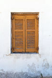 Window with brown shutters Stock Photo