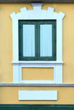 Window of building on orange background, Classic style. Royalty Free Stock Photo