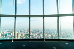 Window of building with Tokyo Tower background. Glass window of building with Tokyo Tower background Royalty Free Stock Photo